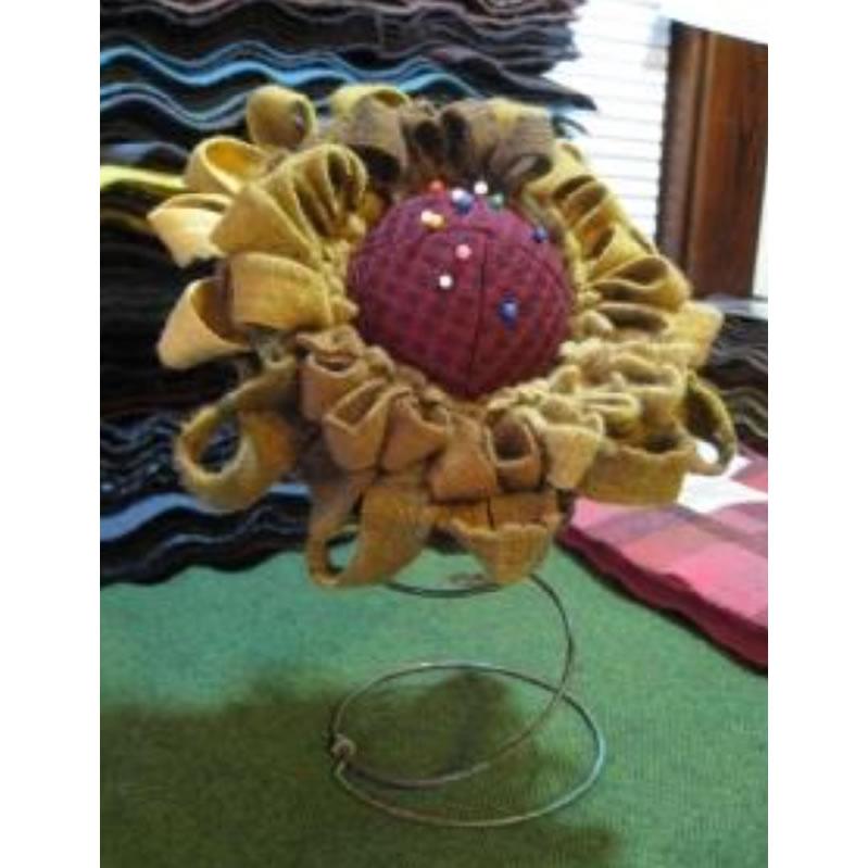 Coneflower pincushion on a bedspring Wool kit!